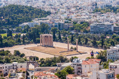 Ancient stone remains in Athens. Ancient stone remains among modern housing in Athens, Greece Stock Image