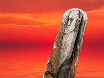 Ancient stone totem sea sunset Royalty Free Stock Photo