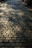 Ancient stone roadbed as background Royalty Free Stock Photography