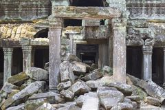 Ancient stone ruin in Angkor Wat temple. Aged demolished building with stone. Khmer kingdom heritage ruin in jungle. stock photo