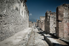 Ancient stone ruins in Pompeii Italy. Dramatic colors Stock Photos