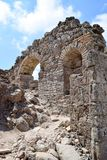 Ancient stone ruins, wall with arches against the sky. Ancient sights of stone Royalty Free Stock Photos