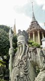 Ancient stone sculpture of Chinese warrior guarding the Royal temple. Wat Pra Kaew and Grand Palace in Bangkok Thailand . Bangkok is the most popular tourist Stock Photos