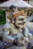 Close up of a traditional Balinese God statue from stone royalty free stock images
