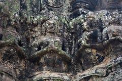 Ancient stone sculptures at The Bayon temple, Angkor, Cambodia Stock Photo