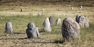 Ancient stone sculptures near Old Burana tower located on famous. Silk road, Kyrgyzstan Royalty Free Stock Image