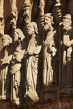 Ancient stone sculptures in a spanish cathedral portico. Olite, Stock Photo