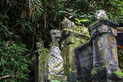 An ancient stone sculptures in Ubud. Sights of Indonesia. Travel around of the world. stock photo