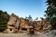 An ancient stone settlement. Unusual rock outcrops in nature reserve. Rocks and forest. miracle of the world stock photography