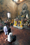 Ancient stone sitting Buddha in Thai temple. Stock Images