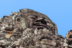 Ancient stone smiling face of the Prasat Bayon Wat temple in the jungle, Angkor wat, Cambodia. Angkor Wat isthe largest Stock Photo