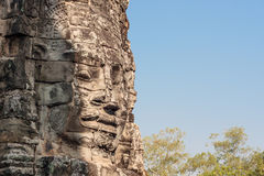 Ancient stone smiling face of the Prasat Bayon Wat temple in the jungle, Angkor wat, Cambodia. Angkor Wat isthe largest Stock Image