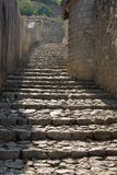 An ancient stone staircase in Pocitelj. Pocitelj is a town in Bosnia and Herzegovina. The historic site of Pocitelj is located on the left bank of the river stock images