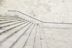 Ancient stone stairs with handrail Royalty Free Stock Photo