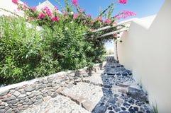 Ancient stone stairs and narrow street on Santorini island Royalty Free Stock Photo