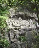 Ancient stone statue of Happy Buddha, Xian, Shaanxi province, China. Ancient stone statue of Happy Buddha and bodhisattvas in cave, park near to Big Wild Goose stock photos