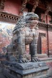 Ancient statue of Lion at Durbar Square in Patan, Nepal. Ancient stone statue of Lion guards the entrance to the Palace at Durbar Square in Patan, Kathmandu royalty free stock image