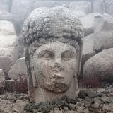 Ancient stone statue on the top of Nemrut mount, Turkey stock images