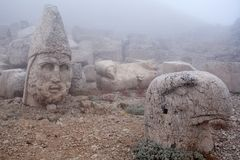 Ancient stone statues on the top of Nemrut mount, Turkey. Ancient stone statues on the top of Nemrut mount, Anatolia, Turkey. In 62 BC, King Antiochus I Theos of Stock Photo