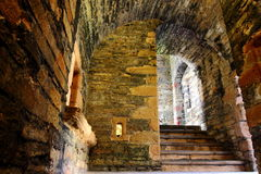 Ancient stone steps descend to dungeon Royalty Free Stock Photo