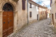 An ancient stone street in the city of Motovun on Istria. An ancient stone street in the city of Motovun on Istria in Croatia, Europe royalty free stock photos