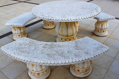Ancient stone table and benches Stock Photos