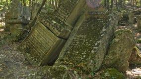 Ancient stone tombstones stock footage