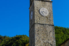 Ancient stone tower with clock Stock Photography