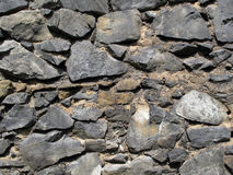 Ancient stone wall. Very old stone wall of middle ages royalty free stock images