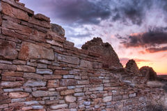 Ancient stone wall. A sunset view of an ancient stone wall taken in Chaco Culture National Historical Park, New Mexico, (USA Royalty Free Stock Photo