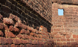 Ancient stone wall of Aguada Fort, Goa, India royalty free stock photo