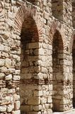 Ancient stone wall with arch in Nesebar Stock Images