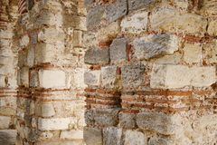 Ancient stone wall with arch in Nesebar Stock Photos