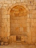 Ancient stone wall with arched niche Royalty Free Stock Image