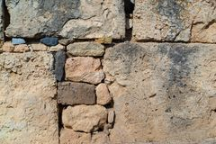 Ancient stone wall for a background closeup Royalty Free Stock Photography