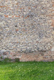 Ancient stone wall background and grass Royalty Free Stock Photo