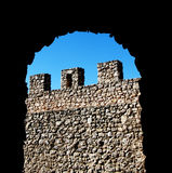 Ancient stone wall with battlements Stock Images