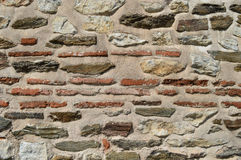 Ancient stone wall. An ancient stone and brick wall Stock Photography