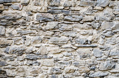 Ancient stone wall  in a castle in italy Stock Image