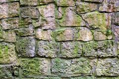 Ancient stone wall covered with moss. stock photography