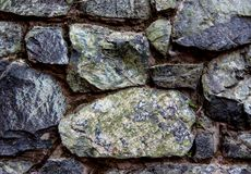 Ancient stone wall detail with calcification royalty free stock photos