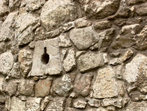 Ancient stone wall with loopholes. Fragment of an ancient stone wall fortifications with loopholes Royalty Free Stock Photos