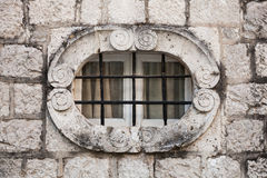 Ancient stone wall with metal window bars Royalty Free Stock Image
