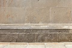 Ancient stone wall with molding and floor background in sunlight. Empty space royalty free stock images