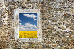 Ancient stone wall with an opening in a wall Royalty Free Stock Image