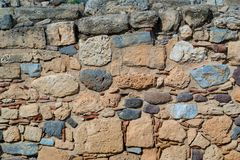 Ancient stone wall for a background Stock Photos