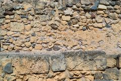 Ancient stone wall for a background Stock Images