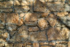 Ancient stone wall for a background closeup Stock Photo