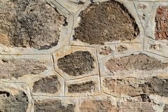 Ancient stone wall for a background closeup Stock Photos