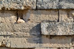 Ancient stone wall for a background closeup Stock Images